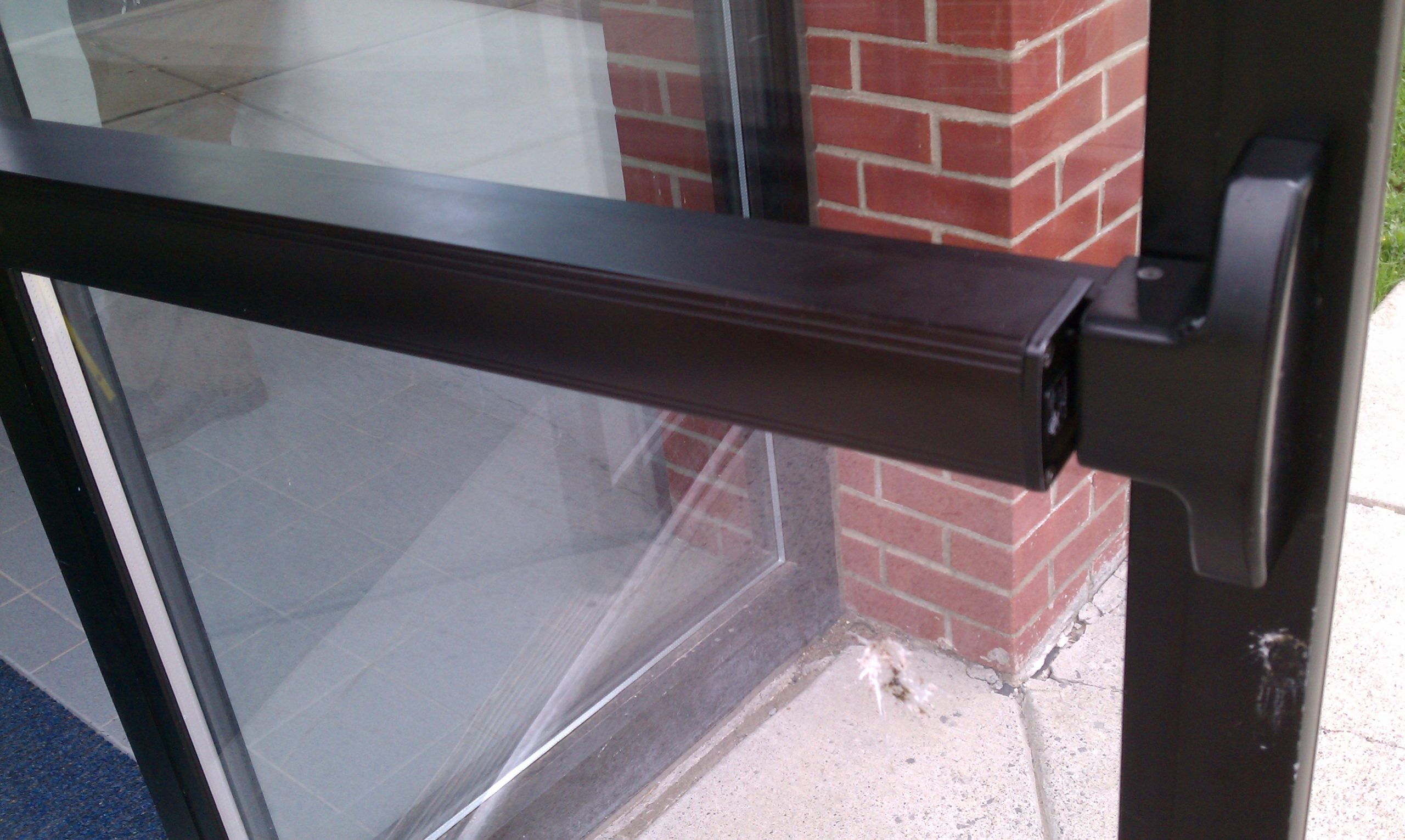 Panic bar on commercial glass exit door