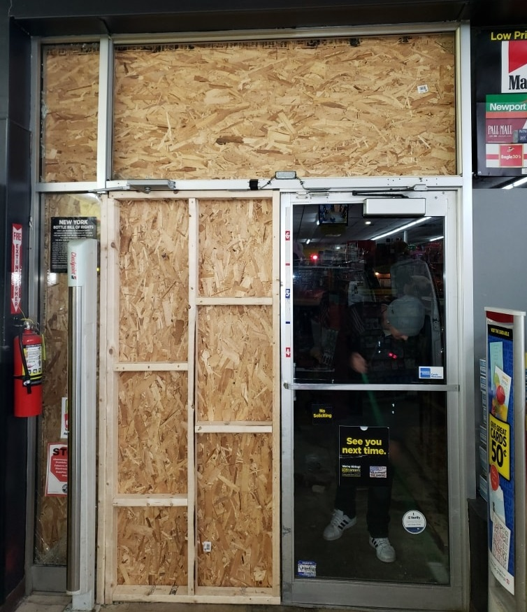 boarded-up-storefront-door-at-night